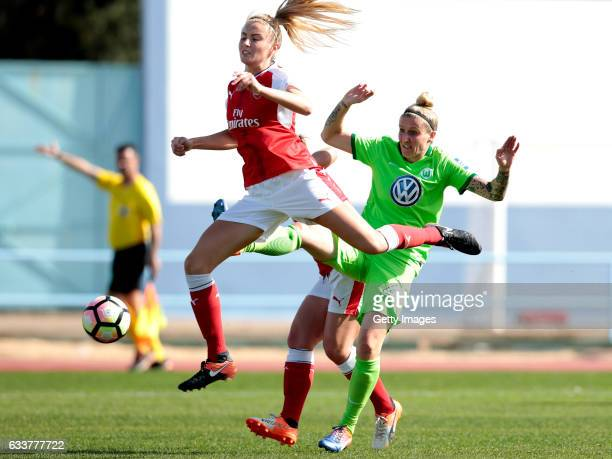 Nilla Fischer of Wolfsburg challenges Leah Williamson of Arsenal during the Women's Friendly Match between VfL Wolfsburg Women's and Arsenal FC Women...