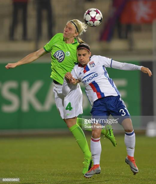 Nilla Fischer of Wolfsburg is challenged by Alex Morgan of Lyon during the UEFA Women's Champions League Quater Final first leg match between VfL...