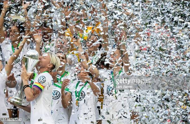 Nilla Fischer of Wolfsburg lifts the trophy after winning the Women's DFB Cup final match between VfL Wolfsburg and SC Freiburg at...