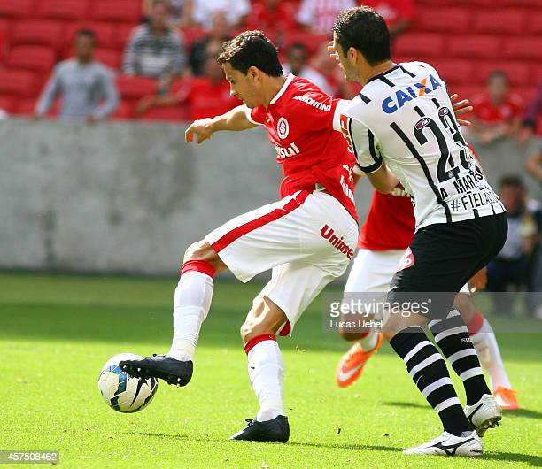 Nilmar of Internacional battles for the ball against Anderson Martins of Corinthians during the match between Internacional and Corinthians as part...