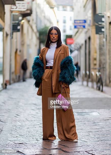 Nilofar Khirzad is wearing Zimmermann jacket and pants brown Gucci belt Gucci bag sunglasses Gucci mink coat vintage is seen at Antonio Marras during...