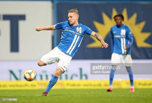 Nils Butzen of Hansa Rostock runs with the ball during the 3 Liga match between Hansa Rostock and Eintracht Braunschweig at Ostseestadion on March 09...