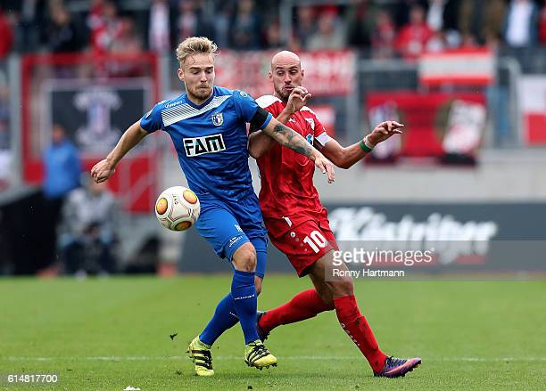 Nils Butzen of Magdeburg and Daniel Brueckner of Erfurt compete during the Third League match between FC Rot Weiss Erfurt and 1 FC Magdeburg at...