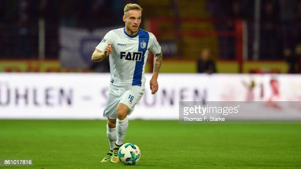 Nils Butzen of Magdeburg runs with the ball during the 3 Liga match between VfL Osnabrueck and 1 FC Magdeburg at Stadion an der Bremer Bruecke on...