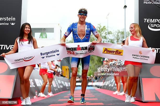 Nils Frommhold of Germany celebrates as he crosses the line to win the the RapperswillJona Ironman on June 5 2016 in Rapperswil Switzerland