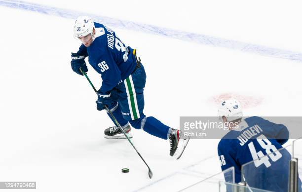 Nils Hoglander of the Vancouver Canucks receives a pass from teammate Olli Juolevi on the first day of the Vancouver Canucks NHL Training Camp on...