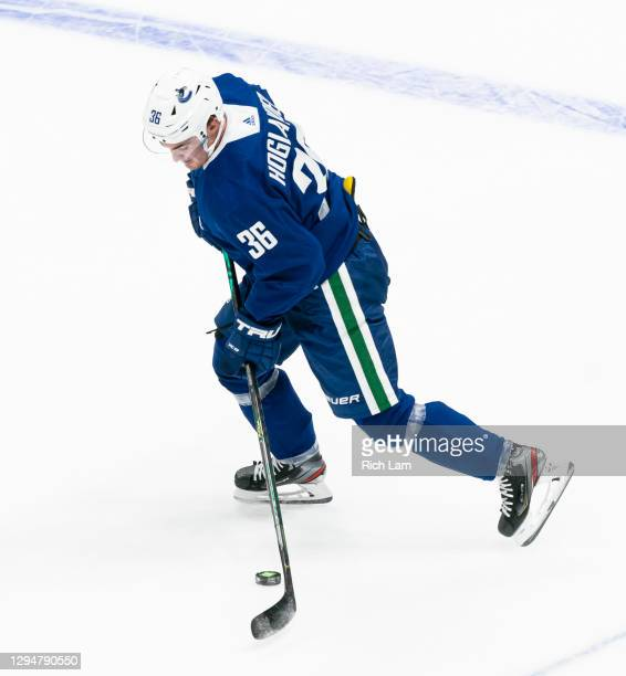 Nils Hoglander of the Vancouver Canucks skates with the puck on the first day of the Vancouver Canucks NHL Training Camp on January 2021 at Rogers...