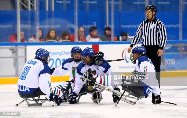 Nils Larch of Italy celebrate with his team mates after scoring a goal in the Ice Hockey Preliminary Round Group A game between Norway and Italy...