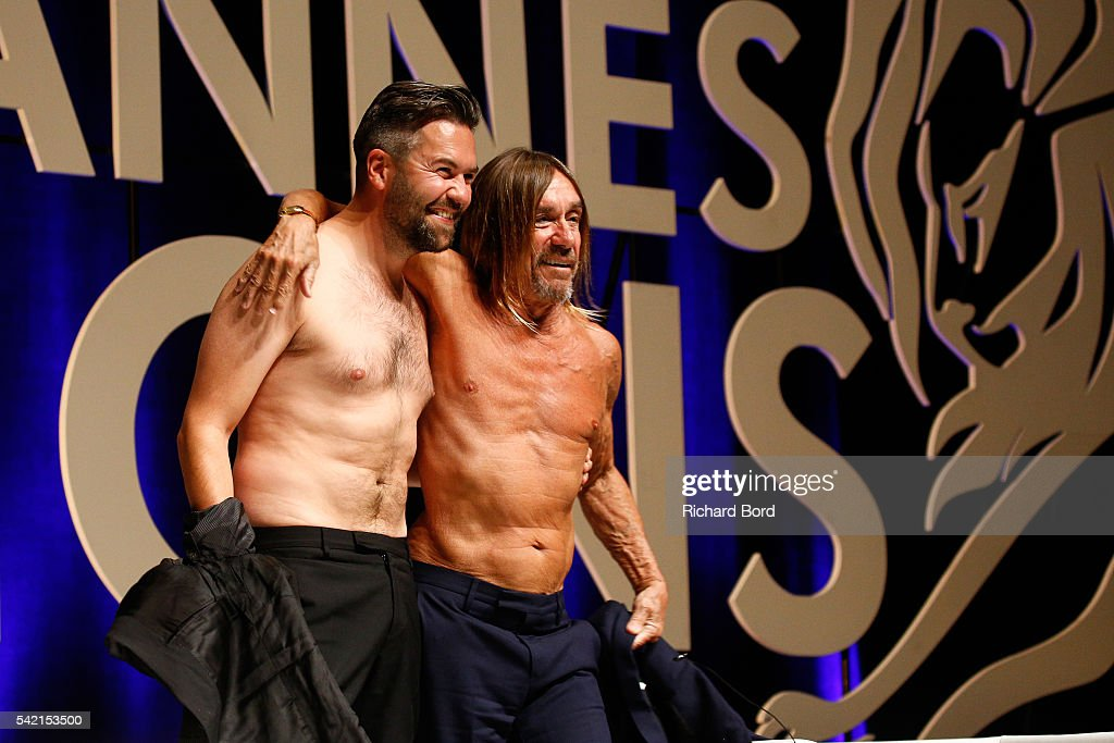 Nils Leonard, Chairman and Chief Creative Officer of Grey London, and Iggy Pop go topless after the 'Do Not Go Gentle' seminar hosted by Grey during The Cannes Lions Festival 2016 on June 22, 2016 in Cannes, France.