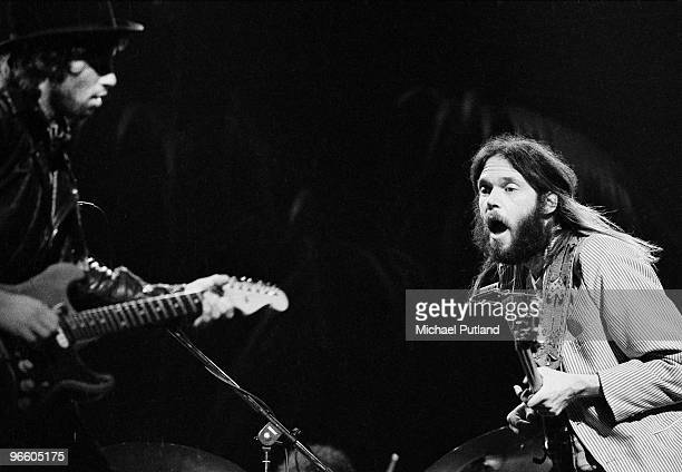 Nils Lofgren and Neil Young performing with rock group Crazy Horse London November 1973