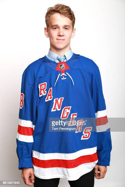 Nils Lundkvist poses after being selected twentyeighth overall by the New York Rangers during the first round of the 2018 NHL Draft at American...
