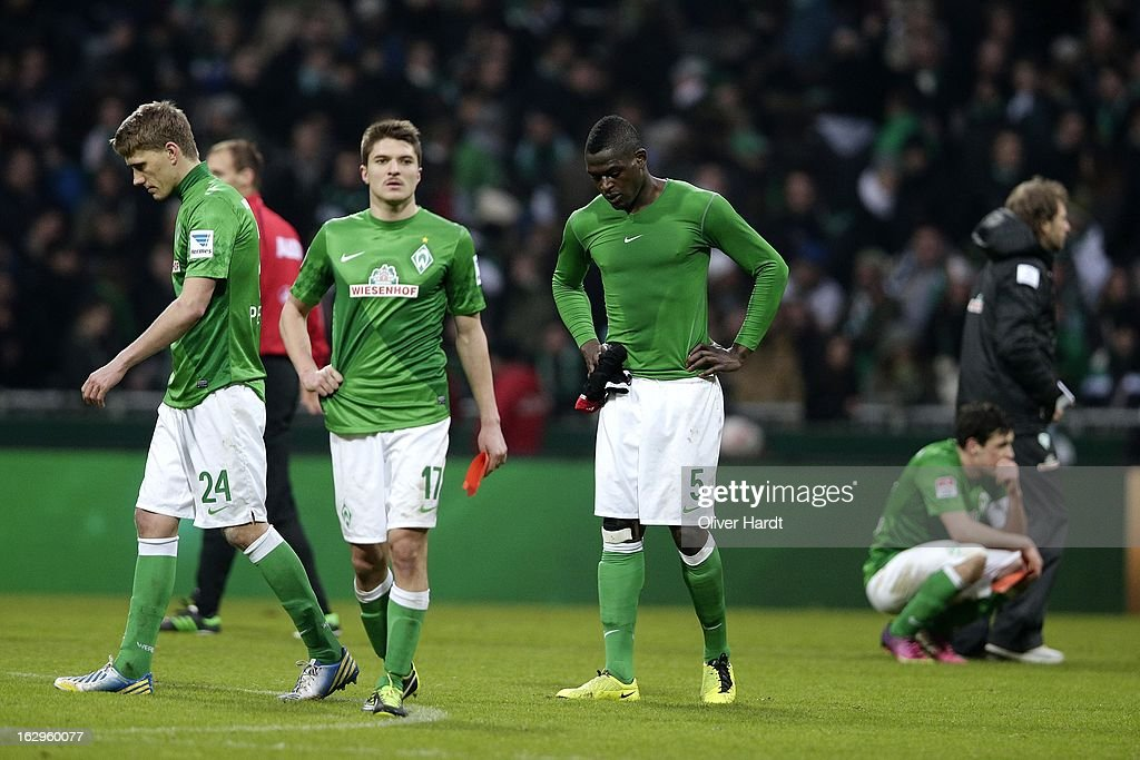 Nils Petersen (L), Aleksandar Ignovski (C) and Assani Lukimya (R) of Bremen look dejected after the Bundesliga match between SV Werder Bremen and FC Augsburg at Weser Stadium on March 2, 2013 in Bremen, Germany.