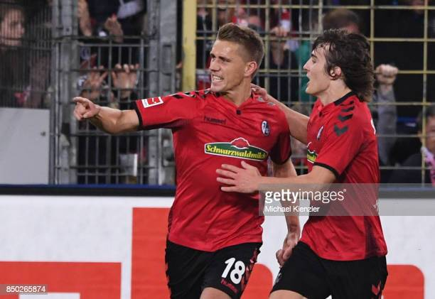 Nils Petersen and Caglar Soeyuencue of SC Freiburg celebrates goal of Petersen during the Bundesliga match between Sport Club Freiburg and Hannover...