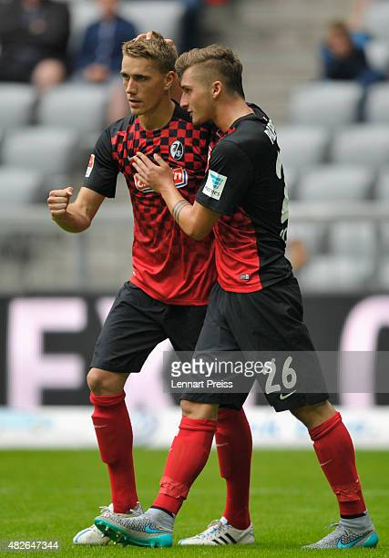Nils Petersen and Maximilian Philipp of SC Freiburg celebrate the opening goal during the 2 Bundesliga match between TSV 1860 Muenchen and SC...