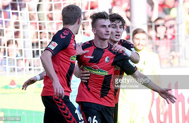 Nils Petersen Maximilian Philipp and Caglar Soeyuencue of Freiburg celebrate the opening goal during the Bundesliga match between Sport Club Freiburg...