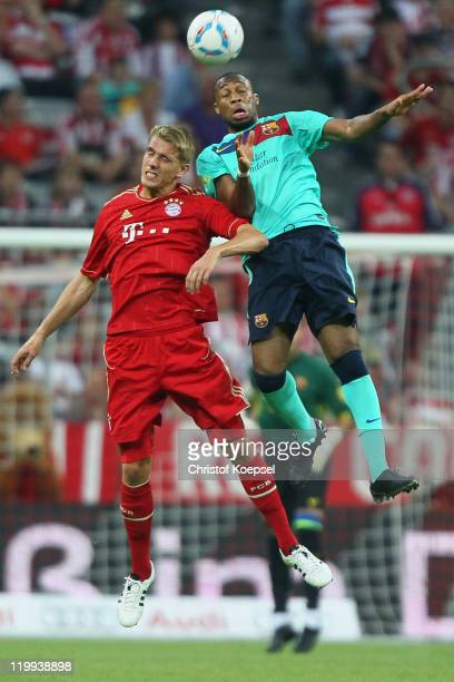 Nils Petersen of Bayern and Seydou Keita of Barcelona go up for a header during the Audi Cup final match between FC Bayern Muenchen and FC Barcelona...