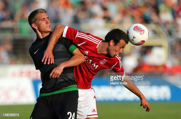 Nils Petersen of Bremen and Andrew Considine of Aberdeen battle for the ball during the friendly match between Werder Bremen and FC Aberdeen at...