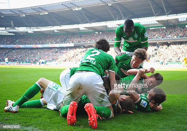 Nils Petersen of Bremen celebrates scoring his goal with teamates during the Bundesliga match between Werder Bremen and 1899 Hoffenheim at...