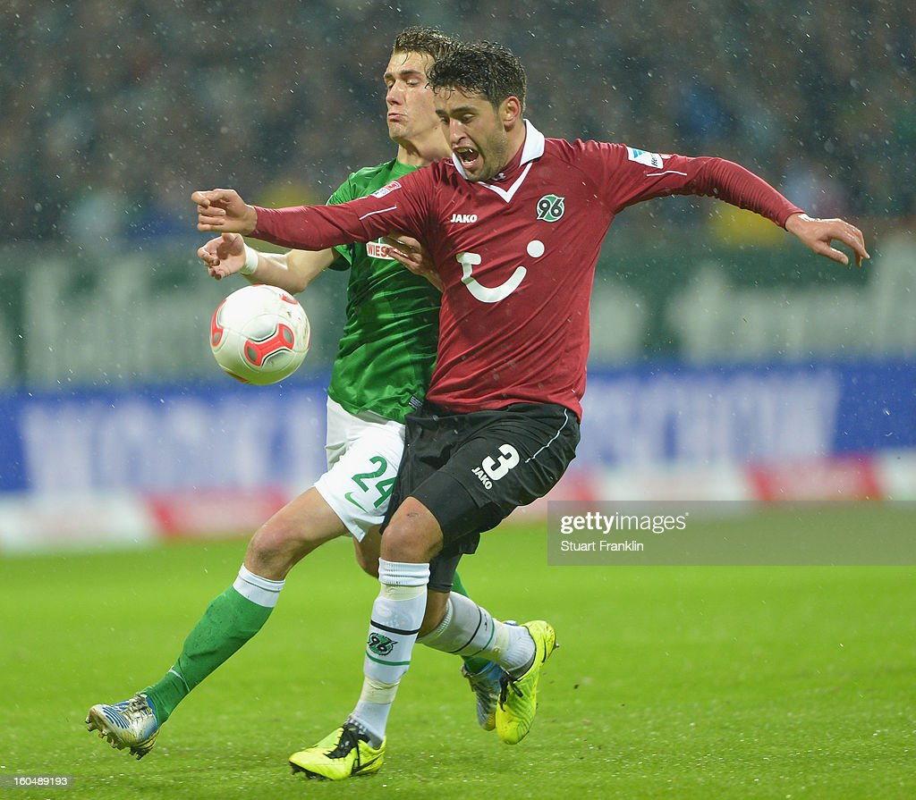 Nils Petersen of Bremen challenges for the ball with Karim Haggui of Hannover during the Bundesliga match between SV Werder Bremen and Hannover 96 at Weser Stadium on February 1, 2013 in Bremen, Germany.