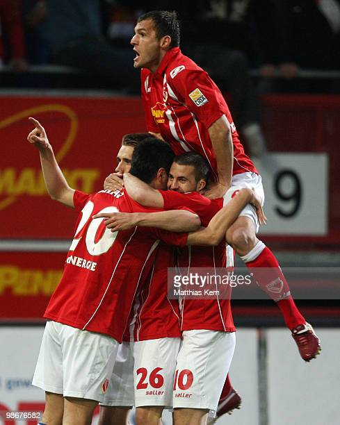 Nils Petersen of Cottbus jubilates with team mates after scoring the first goal during the Second Bundesliga match between FC Energie Cottbus and...