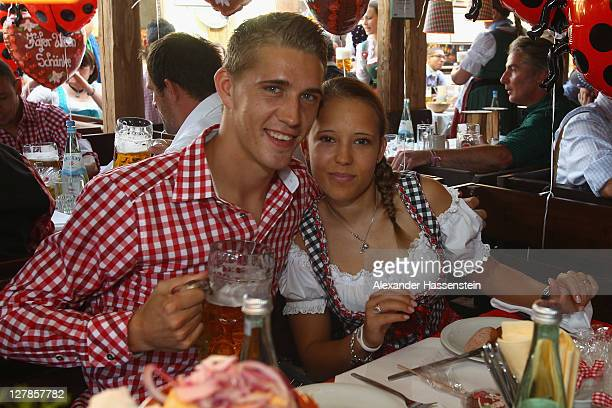 Nils Petersen of FC Bayern Muenchen attends with Annemarie Ziege the Oktoberfest beer festival at the Kaefer Wiesnschaenke tent on October 2 2011 in...