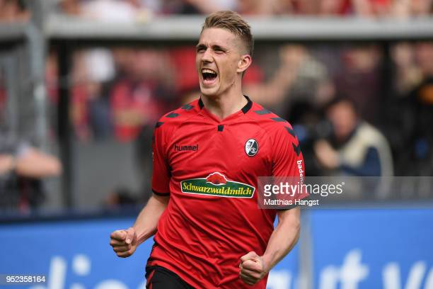 Nils Petersen of Freiburg celebrates after he scored a goal to make it 20 during the Bundesliga match between SportClub Freiburg and 1 FC Koeln at...