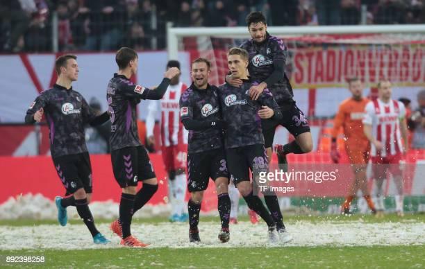 Nils Petersen of Freiburg celebrates after scoring a goal with Yoric Ravet of Freiburg Pascal Stenzel of Freiburg Caleb Stanko of Freiburg and Tim...