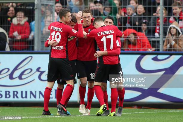 Nils Petersen of Freiburg celebrates after scoring his team's first goal with his team mates during the Bundesliga match between Sport-Club Freiburg...