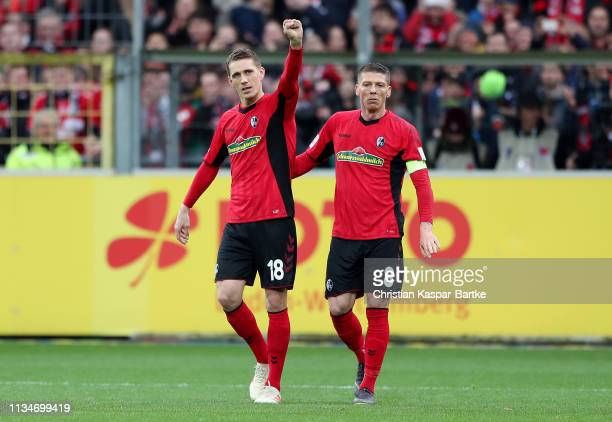 Nils Petersen of Freiburg celebrates after scoring his team's first goal with Mike Frantz of Freiburg during the Bundesliga match between Sport-Club...