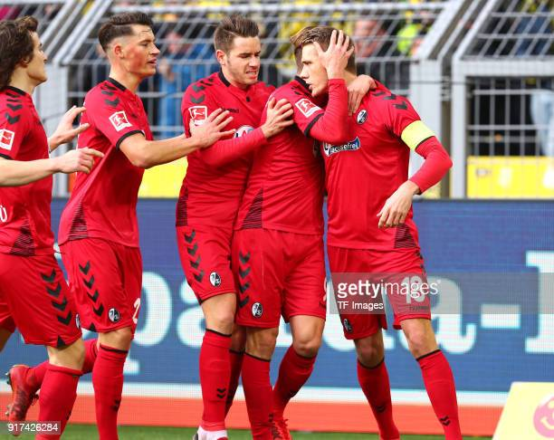 Nils Petersen of Freiburg celebrates after scoring his team`s first goal with Caglar Soeyuencue of Freiburg MarcOliver Kempf of Freiburg Christian...