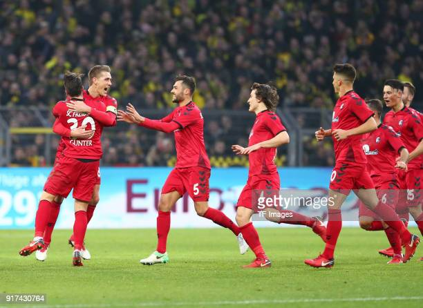 Nils Petersen of Freiburg celebrates after scoring his team`s second goal with Christian Guenter of Freiburg Manuel Gulde of Freiburg Caglar...