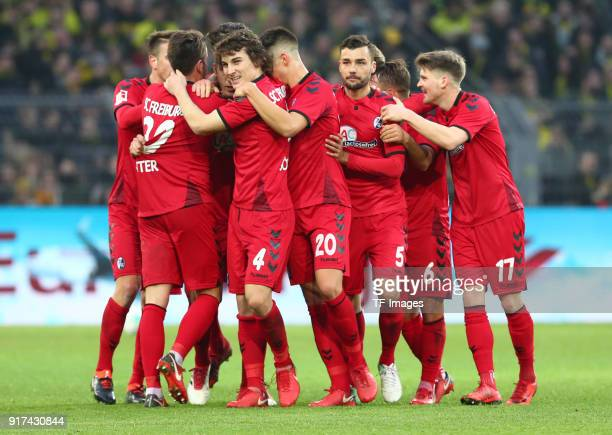 Nils Petersen of Freiburg celebrates after scoring his team`s second goal with Christian Guenter of Freiburg Caglar Soeyuencue of Freiburg MarcOliver...