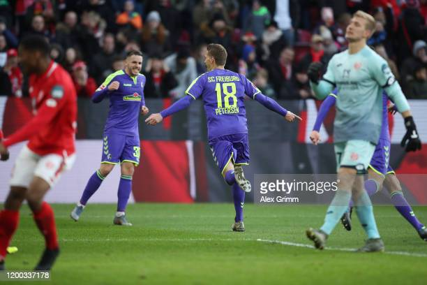 Nils Petersen of Freiburg celebrates his team's second goal with team mate Christian Guenter during the Bundesliga match between 1 FSV Mainz 05 and...