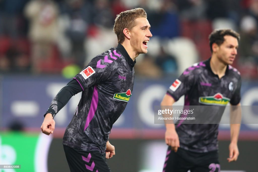 Nils Petersen of Freiburg celebrates scoring the 2nd team goal during the Bundesliga match between FC Augsburg and Sport-Club Freiburg at WWK-Arena on December 16, 2017 in Augsburg, Germany.