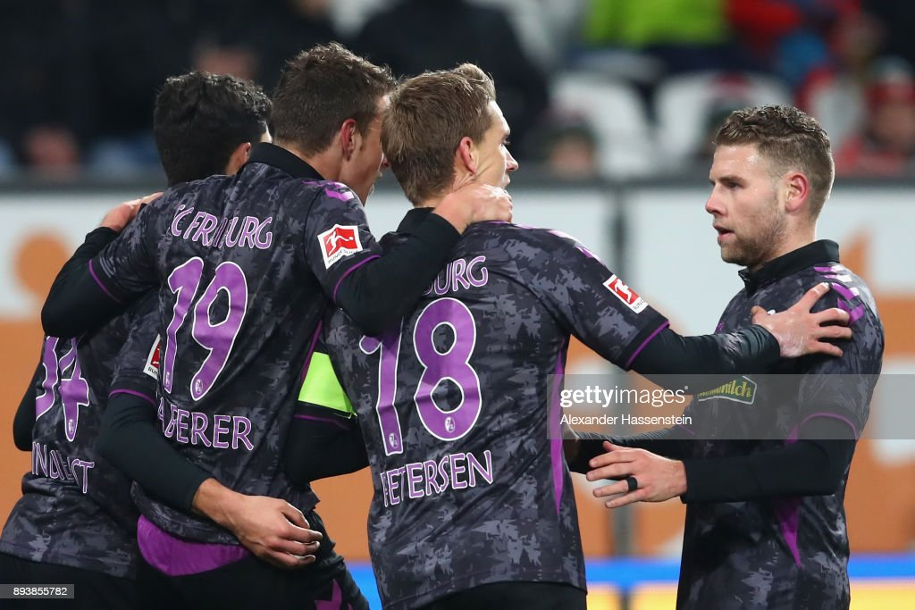 Nils Petersen (2nd R) of Freiburg celebrates scoring the 3rd team goal with hsi team mates during the Bundesliga match between FC Augsburg and Sport-Club Freiburg at WWK-Arena on December 16, 2017 in Augsburg, Germany.