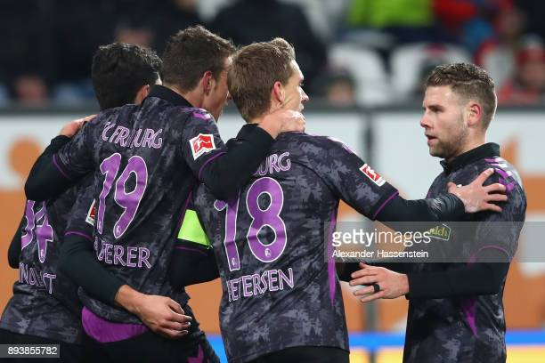 Nils Petersen of Freiburg celebrates scoring the 3rd team goal with hsi team mates during the Bundesliga match between FC Augsburg and SportClub...