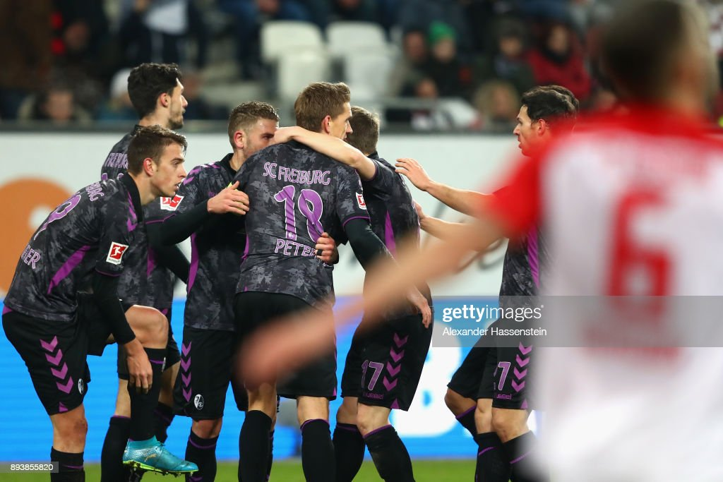Nils Petersen (C) of Freiburg celebrates scoring the 3rd team goal with hsi team mates during the Bundesliga match between FC Augsburg and Sport-Club Freiburg at WWK-Arena on December 16, 2017 in Augsburg, Germany.