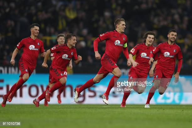 Nils Petersen of Freiburg celebrates with his team after he scored a long distance goal to make it 12 during the Bundesliga match between Borussia...
