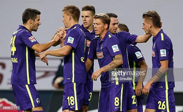 Nils Petersen of Freiburg celebrates with team mates after scoring his team's first goal during the Second Bundesliga match between RB Leipzig and SC...