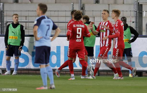 Nils Petersen of Freiburg celebrates with teammates after scoring his sides first goal during the Bundesliga match between SportClub Freiburg and...