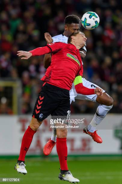 Nils Petersen of Freiburg challenges Denis Zakaria of Moenchengladbach during the Bundesliga match between SportClub Freiburg and Borussia...