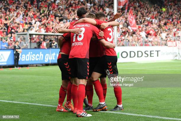 Nils Petersen of Freiburg is celebrated by his team after he scored a goal to make it 20 during the Bundesliga match between SportClub Freiburg and 1...