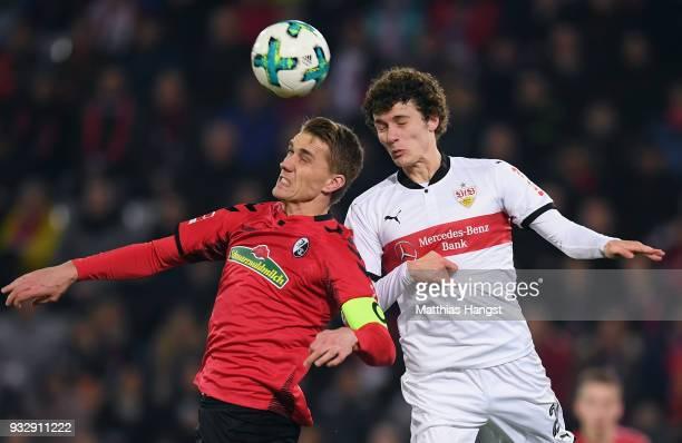 Nils Petersen of Freiburg jumps for a header with Benjamin Pavard of Stuttgart during the Bundesliga match between SportClub Freiburg and VfB...