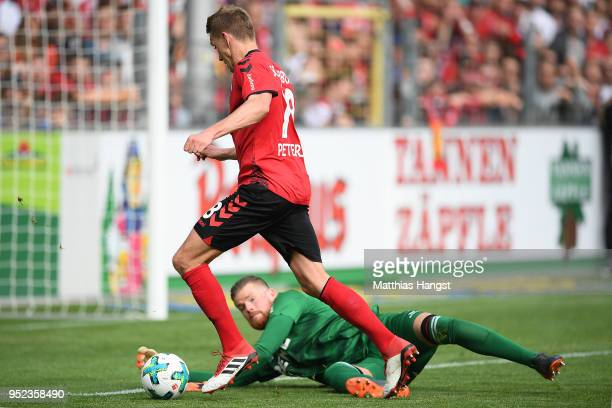 Nils Petersen of Freiburg scores a goal past goalkeeper Timo Horn of Koeln to make it 2:0 during the Bundesliga match between Sport-Club Freiburg and...