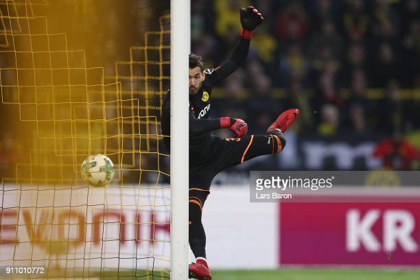 Nils Petersen of Freiburg scores a long distance goal past Roman Buerki of Dortmund to make it 12 during the Bundesliga match between Borussia...