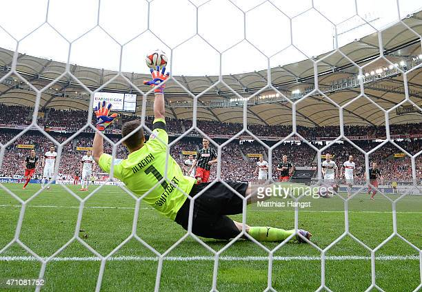 Nils Petersen of Freiburg scores his team's first goal by a penalty kick against goalkeeper Sven Ulreich of Stuttgart during the Bundesliga match...