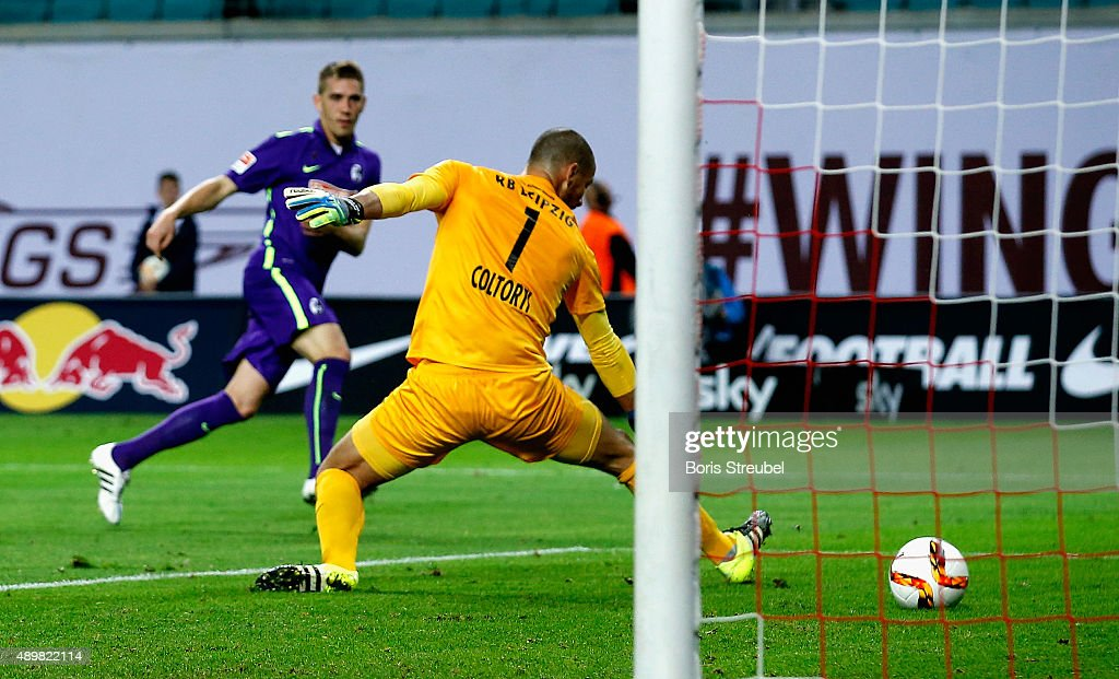 Nils Petersen (L) of Freiburg scores his team's first goal during the Second Bundesliga match between RB Leipzig and SC Freiburg at Red Bull Arena on September 24, 2015 in Leipzig, Germany.