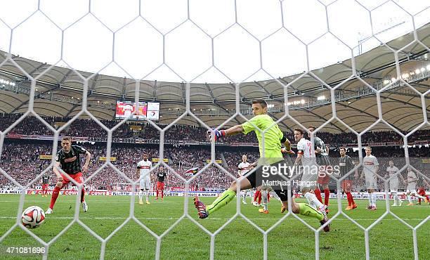 Nils Petersen of Freiburg scores his team's second goal past goalkeeper Sven Ulreich of Stuttgart during the Bundesliga match between VfB Stuttgart...