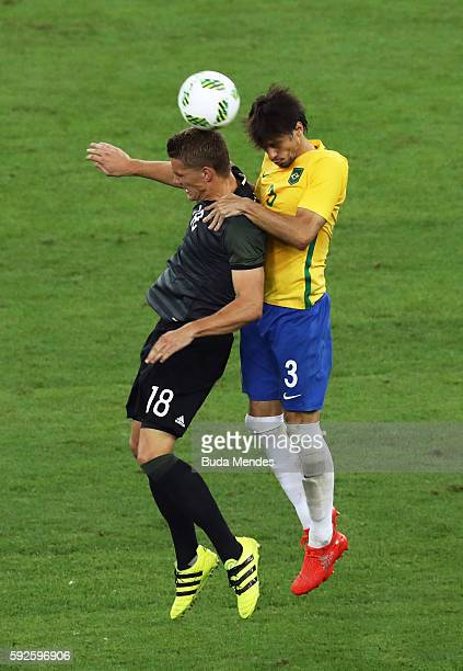 Nils Petersen of Germany and Rodrigo Caio of Brazil during the Men's Football Final between Brazil and Germany at the Maracana Stadium on Day 15 of...