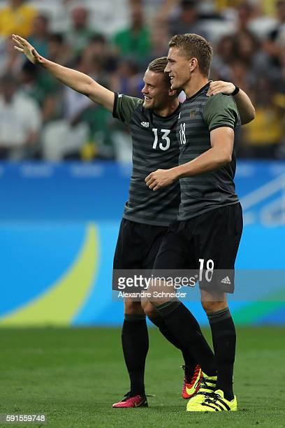 Nils Petersen of Germany celebrates scoring a goal with team mate Philipp Max of Germany during the Men's Semifinal Football match between Nigeria...
